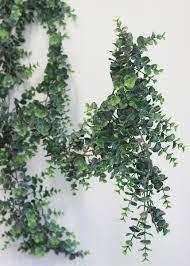 faux outdoor eucalyptus garland trending wedding decorations