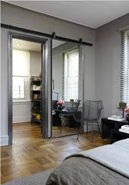 a sliding barn door mirror love this and it almost makes the room