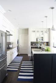 Kitchen Cabinets Virginia White Kitchen Cabinets With Black Island And Navy Striped Rug Via