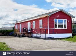 newly constructed red vinyl siding mobile home at the local