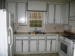 How To Paint Old Kitchen Cabinets by How To Diy Repainting Kitchen Cabinets
