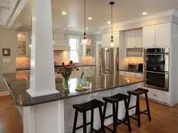 white shaker kitchen stone countertops hardwood flooring