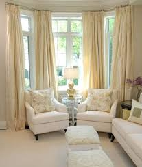 bay window living room ideas living rooms silver l chair set soft butter yellow silk
