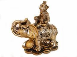 monkey on elephant statue