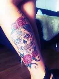 collection of 25 pretty flowers with sugar skull tattoos on thigh