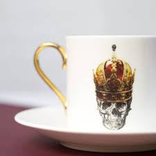 skull in red crown espresso cup and saucer by melody rose