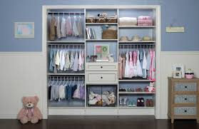 interior opened baby closet organizers and three hanging clothes