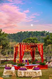 wedding backdrop setup and purple theme outdoor mandap decor in the backdrops