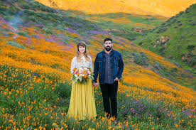 super colorful colorful super bloom engagement session in a poppy field green