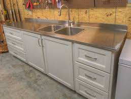 full overlay shaker with inlay in an alabaster finish u0026 stainless