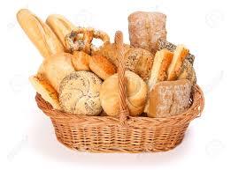 bakery basket fresh bakery products in wicker basket on white background stock