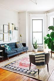 condo decorating ideas living room round white leather storage