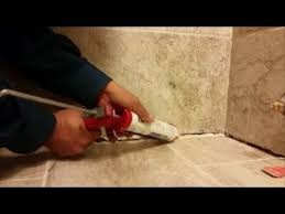 how to seal a big gap between tile floor and tile wall in a