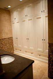 Spanish Revival Bathrooms Our Blog - Floor to ceiling cabinets for bathroom