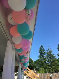 outdoor baby shower mayve a nice new rocker under there for mommy spring baby shower pink coral and teal balloon decor really pretty for outside