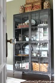 Dining Room Glass Cabinets by Spring House Decorating Tour Industrial Storage And Display