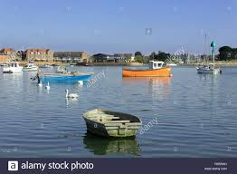 collection of small boats or tenders in chichester harbour at