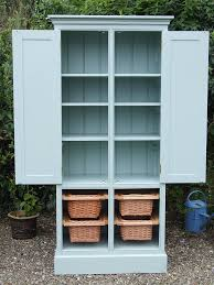 freestanding larder cupboard with four baskets