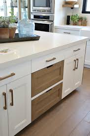 how to clean factory painted kitchen cabinets our best tips for staining cabinets or re staining