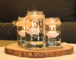 30 rustic mason jar centerpiece with floating candles on wood