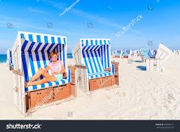 happy woman sitting beach chair enjoying stock photo 482570161