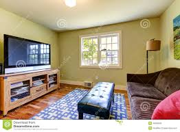 simple family room with brown sofa and tv stock photo image