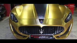 maserati gold chrome car wrap dubai masarati granturismo in gold chrome brush done