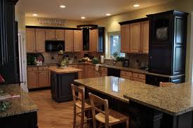 black kitchen appliances ideas light colored oak cabinets with granite countertop detailed