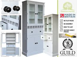 contemporary painted 7ft tall glazed kitchen storage cabinet with