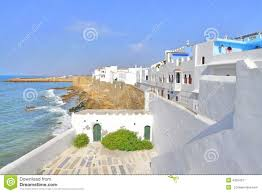 Moroccan Houses by Beautiful Houses On The Coast In Asilah Morocco Stock Photo
