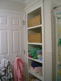 Small Bathroom Laundry Kid U0027s Bathroom Replaced The Linen Closet With Open Shelving For