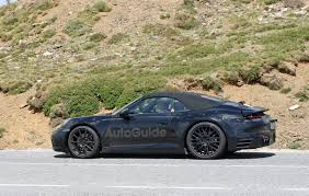 green porsche convertible porsche 992 convertible resurfaces for weather testing