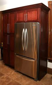 cherrywood kitchen cabinet pantry with built in refrigerator