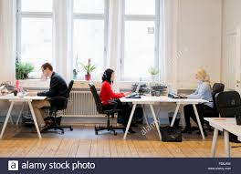 Office View by Sweden Side View Of People Working In Office Stock Photo Royalty