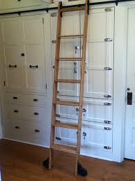 8 clever ways to use a rolling library ladder all over the house