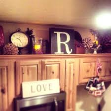 Decorations On Top Of Kitchen Cabinets Above Kitchen Cabinet Decorations Cabinet Best Designs Ideas