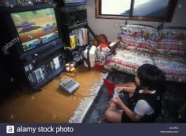 japanese child playing video games on a game console in the front