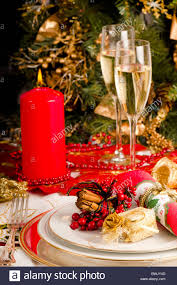 christmas table setting with wine glass and two glasses of