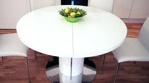 extendable dining room table next round ikea and chairs sets