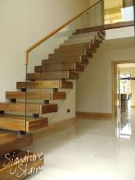 Kitchen Design With Basement Stairs Floating Wooden From Kitchen Area Upstairs Or Down Into Basement