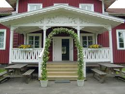 wedding arches definition houses wedding arch porch flowers pots pink roses rustic site