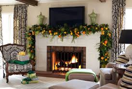 mantel decorated with autumn decor using candles and pumpkins