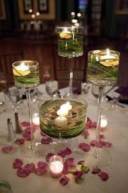 Vase And Candle Centerpieces by Low Centerpiece Idea That Allows Guests To Have Conversation