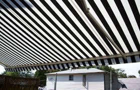 House Awnings Retractable Canada Residential Striped Awning Over Deck Rolltec Retractable