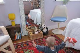 baby in a one bedroom apartment fitting a nursery in a one bedroom apartment popsugar home