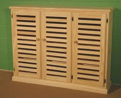 varnished oak wood shoe storage cabinet with louvers doors of
