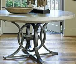 grey round dining table and chairs baskets on wall lantern round