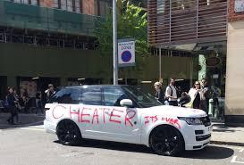 spurned lover gets public revenge by graffiting range rover parked