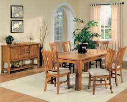 solid oak dining room table and 6 chairs wood furniture for sale