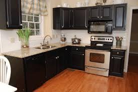 matte black kitchen cabinet steel stove light brown smooth rock